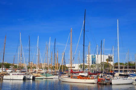 BARCELONA, SPAIN - MAY 16, 2017: View of the sailboats on the pier in center of Barcelona in sunny day.