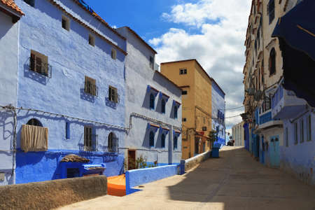 CHEFCHAOUEN, MOROCCO - MAY 29, 2017: View of the historical buildings in Chaouen. The city is noted for its buildings in shades of blue and that makes Chefchaouen very attractive to visitors. Редакционное