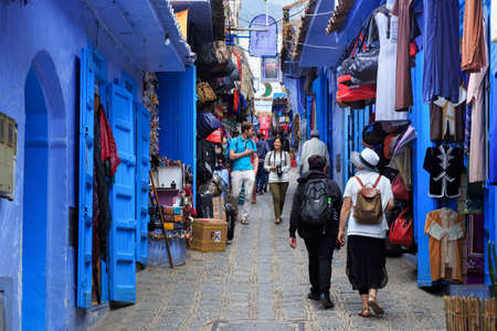 CHEFCHAOUEN, MOROCCO - MAY 28, 2017: Unknown people in Medina in Chaouen. The city is noted for its buildings in shades of blue and that makes Chefchaouen very attractive to visitors.