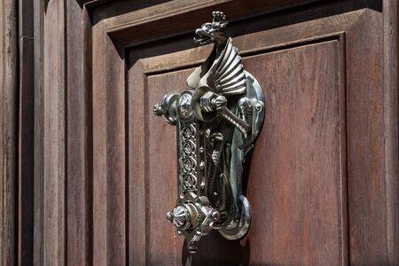 Old vintage doorknob in shape of the dragon.