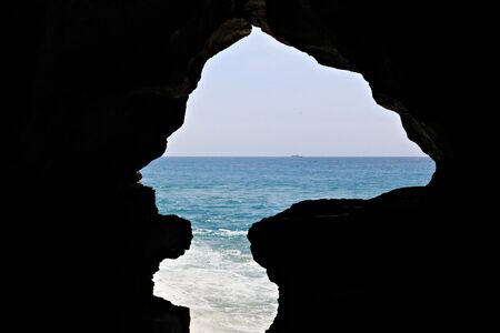 View of the The Caves of Hercules in Cape Spartel, Morocco. Is an archaeological cave complex near Atlantic Ocean, situated 14 kilometres west of Tangier, the popular tourist attraction. Фото со стока