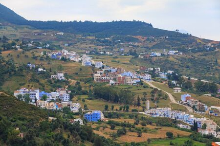 View of the suburbs of Chefchaouen, Morocco. The city, also known as Chaouen is noted for its buildings in shades of blue and that makes Chefchaouen very attractive to visitors. 스톡 콘텐츠