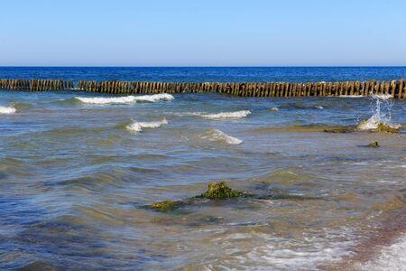 Old german wooden breakwater on the Baltic Sea coast.