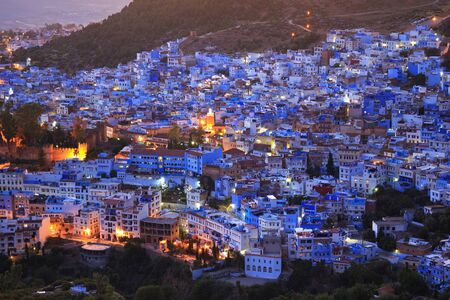 Aerial evening view of Chefchaouen in Morocco. The city is noted for its buildings in shades of blue and that makes Chefchaouen very attractive to visitors. 스톡 콘텐츠