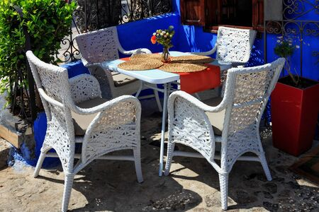 View of the chairs near one of the cafe in Chefchaouen, Morocco. The city, also known as Chaouen is noted for its buildings in shades of blue and that makes Chefchaouen very attractive to visitors.
