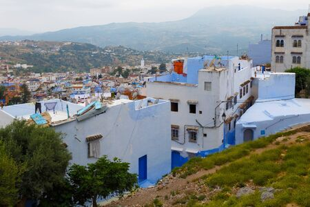 View of the blue walls of old buildings in Chefchaouen, Morocco. The city, also known as Chaouen is noted for its buildings in shades of blue and that makes Chefchaouen very attractive to visitors.