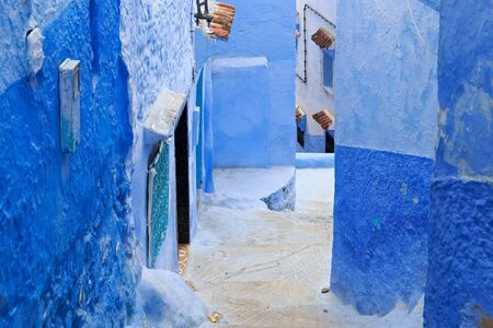 View of the blue walls of Medina quarter in Chefchaouen, Morocco. The city, also known as Chaouen is noted for its buildings in shades of blue and that makes Chefchaouen very attractive to visitors.