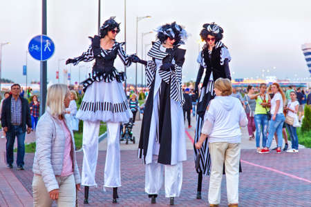 KALININGRAD, RUSSIA - JUNE 16, 2018: Performers on the stilts entertain the audience on the days of  World Cup of 2018 in Russia.