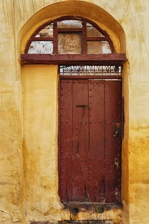 Old wooden door in Meknes medina. Meknes is one of the four Imperial cities of Morocco and the sixth largest city by population in the kingdom.