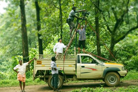 filmmaker: Film Crew On Location Evening Shoot. 4K Camera & Cinematographer. Filmmaker