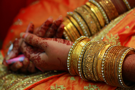Young woman hand closeup Indian wedding jewelry, Indian bride, Stock Photo