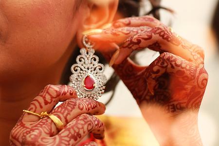 Earrings in the bride's ear, closeup shot