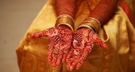 Beautiful mehendi design on hand, young bride girl hand