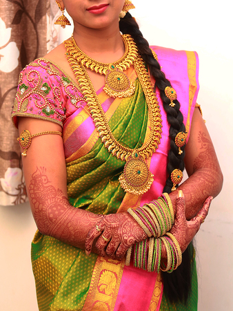 Traditional Young bride in wedding dress, South Indian wedding rituals