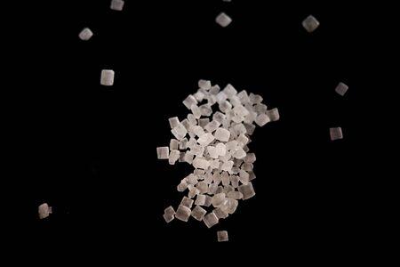 Sugar crystals macro shot on black backgrounds