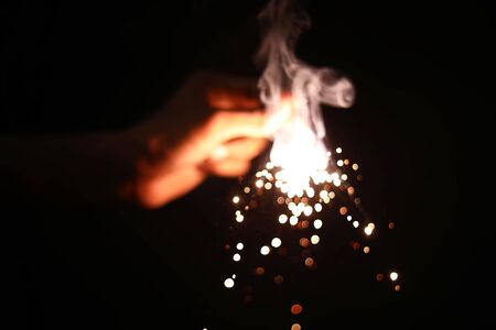 hand holding a burning sparklers Фото со стока