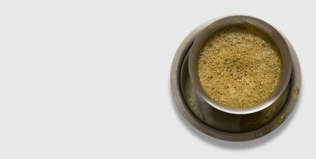 South Indian coffee served in steel glasses - white background Stock Photo