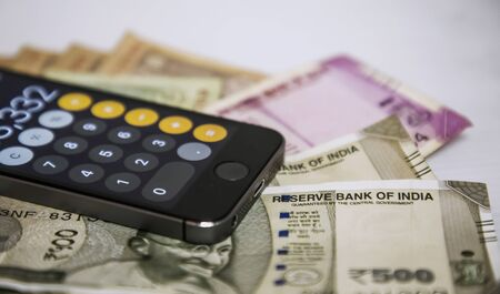 Close up view of Mobile Phone Calculate and new Indian rupees Stock fotó