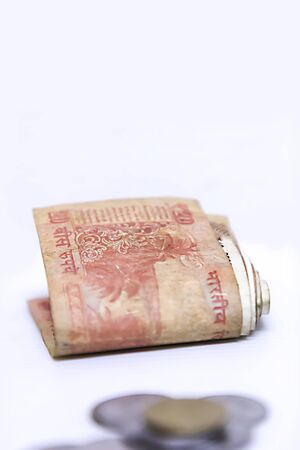 Indian currency bank notes of 10, 20 rupees, Indian currency note Folded on white background