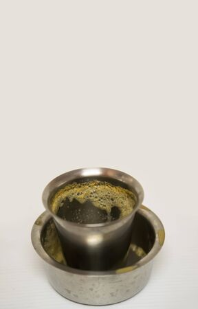 Empty glass cup of coffee, South Indian filter coffee is famous coffee in steel cup