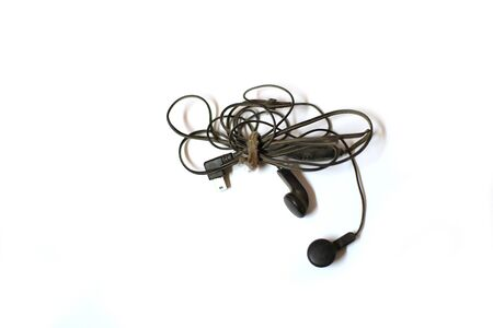 Top view of Black Earphones on white background. Copy spaces