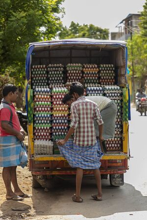 People deliver eggs to the local store, Local street
