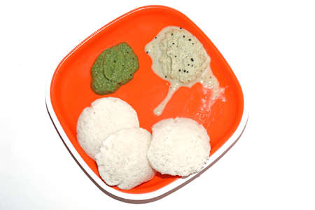 South Indian breakfast recipe Idly or Idli / rice cake served with coconut chutney Stock Photo