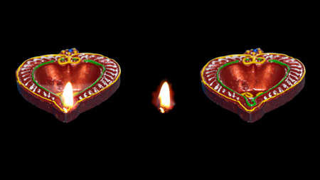 Diya lamp with fire. Traditional Divali festival.