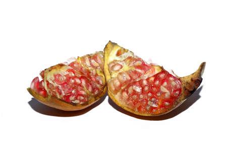 Juicy pomegranate fruit isolated on white backgrounds