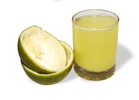 mosambi or sweet lemon juice and cut fresh sweet lemons peels isolated on white backgrounds Imagens