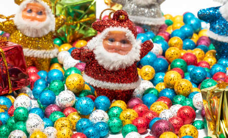 Santa Claus and Colorful balls on white backgrounds. Imagens