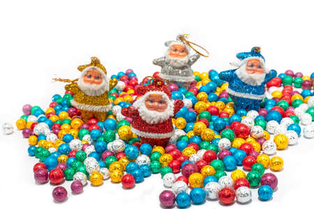 Santa Claus with colorful balls on white backgrounds