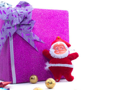 The statue of Santa Claus with the large gift box is isolated on a white backgrounds