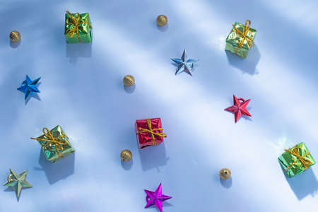 Gift boxes with star and Golden Christmas baubles decoration on a white or snow background.