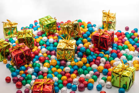 Gift boxes with colorful balls on white backgrounds Imagens
