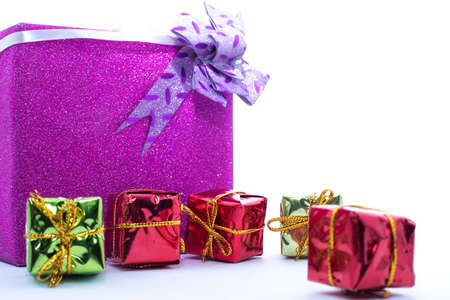Christmas gift box. Christmas presents in Multi-colored boxes isolated on a white backgrounds