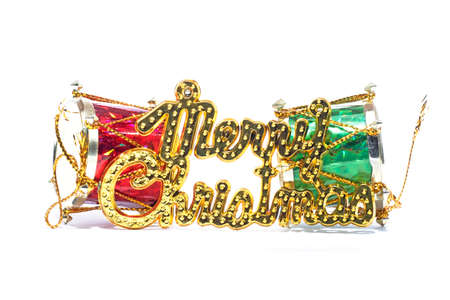 Merry Christmas golden text with red and green drum against the white backgrounds Imagens