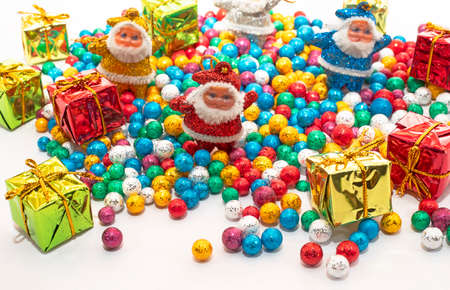Santa Claus with colorful balls and Gift boxes on white backgrounds