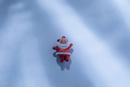 Santa Claus with sunlight rays on a white or snow background. Imagens