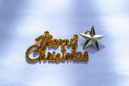 Christmas composition. Merry Christmas gold text with star isolated on white background.
