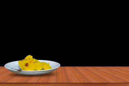 Indian traditional sweet kesari or Semolina dessert on wooden tables Standard-Bild