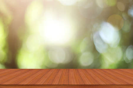 Empty wood table and defocused bokeh blur backgrounds with sunlight. product display template.