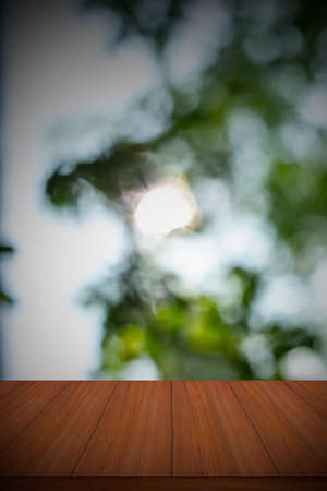 Empty wood table and defocused bokeh and blur backgrounds with sunlight. product display template. Standard-Bild