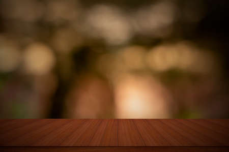 Wood table top against a shiny sunlight bokeh backgrounds - can be used to showcase your products