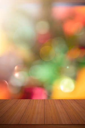 Blank table product. Empty wooden deck table with abstract blurred bokeh natural color background and sunlight. A place for your food and product display montage.