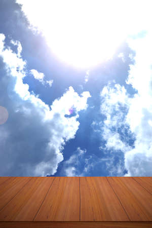 Wood table top in blue sky with sunlight backgrounds