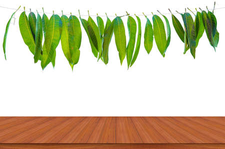 Mango leaf garland with wooden table backgrounds. holiday ornate decoration.