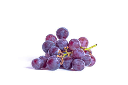 Red wet grape with drops isolated on white background