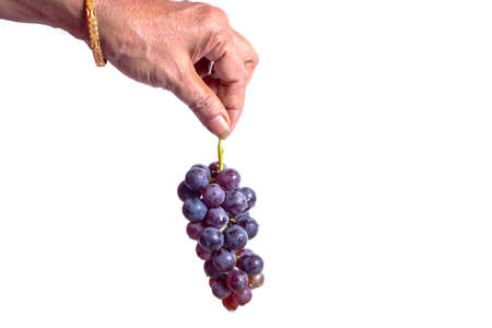 woman hand holding bunch of fresh grapes with water drops