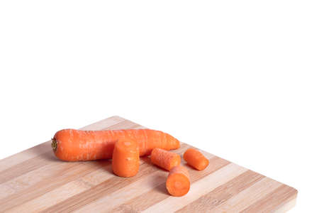 Fresh carrots on on the cutting board isolated on the white backgrounds